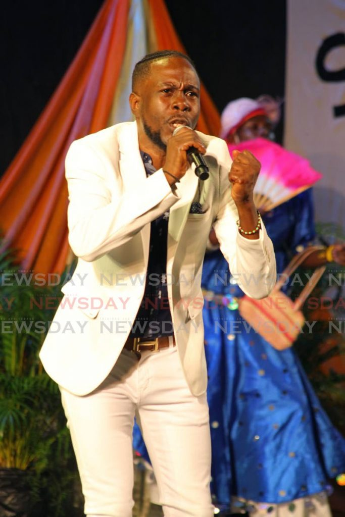 """Addelon """"Banjela"""" Braveboy performs T'is We Season  at the 36th annual National Action Cultural Committee(NACC) Young Kings Calypso Competition at the Queen's Park  Savannah, Port of Spain, Wednesday. - ROGER JACOB"""