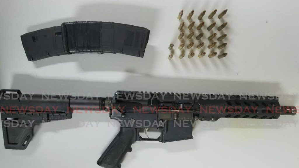 A Hebron assault rifle and 27 rounds of ammunition seized by police from a 25-year-old Diego Martin man on Wednesday night.  PHOTO COURTESY THE TTPS -