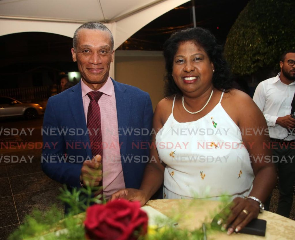 Minister of Foreign and Caricom Affairs Dennis Moses with Ag High Commissioner of Guyana Deborah Yaw at a reception to mark that country's 50th anniversary of being a Republic, at Guyana High Commission on Thursday.   - SUREASH CHOLAI