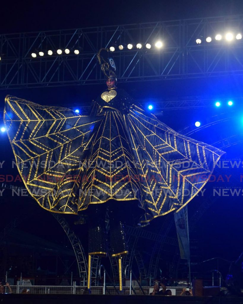 Sevel Nicholas is The Power of Love, the queen of Peter Minshall's Kinetic Mas' Mas Pieta at the Queens of Carnival competition at Queen's Park Savannah, Port of Spain on Thursday night.    - Vidya Thurab