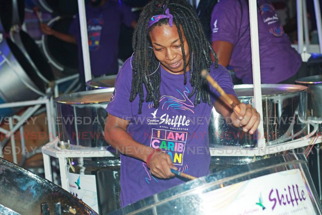This player gets into the music at CAL's sponsors appreciation event at Skiffle Steel Orchestra, Coffee Street, San Fernando. - CHEQUANA WHEELER