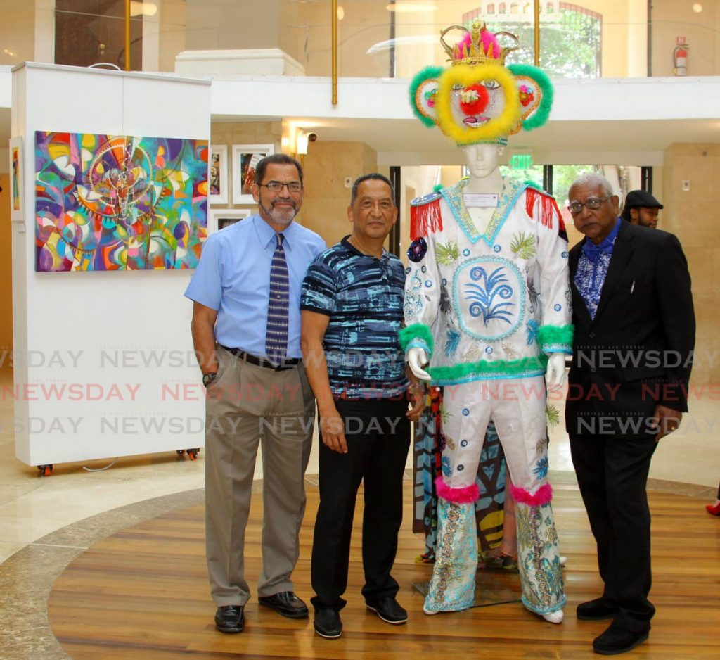 (centre) Ansel Wong, Advisory Council chairman of Notting Hill carnival alongside, Francis Williams-Smith, left, and Keith Simpson, members of Belmont Exotic Stylish Sailors at the launch of a Carnival exhibition in the Rotunda at the Red House. - ROGER JACOB