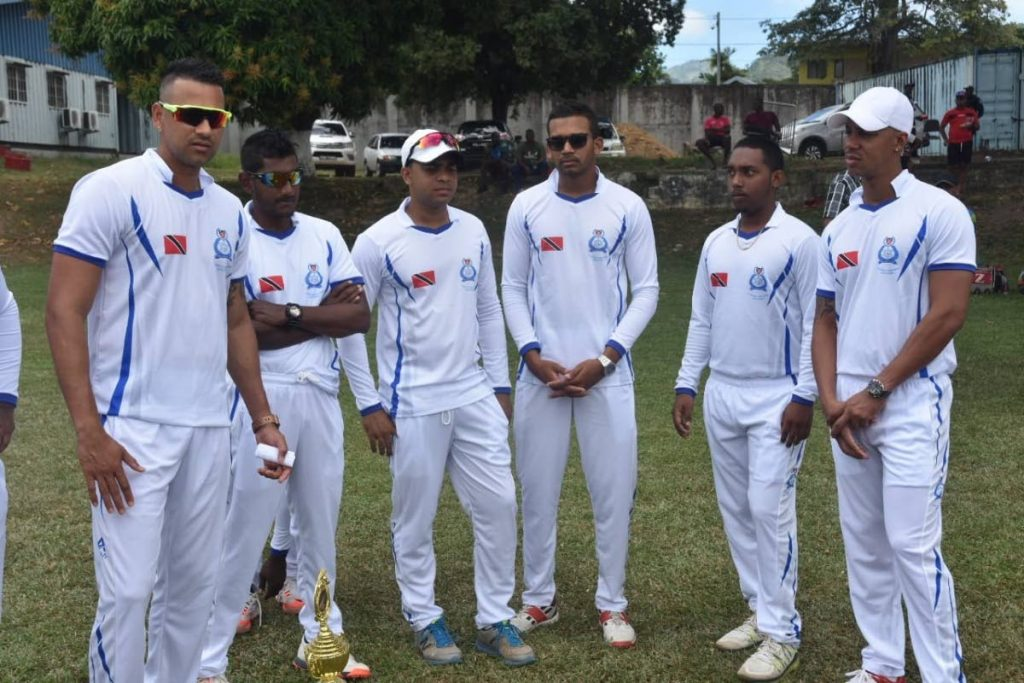 Rayad Emrit, left, and Lendl Simmons, right, along with other members of the TT Police Service cricket team.  -