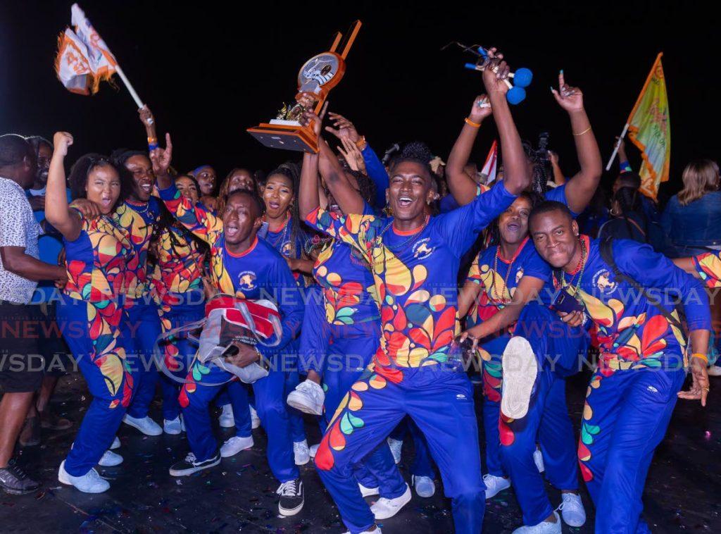 NGC Couva Joylanders members celebrate winning the National Panorama medium conventional bands title on Sunday at the Dwight Yorke Stadium, Tobago. PHOTO BY DAVID REID - DAVID REID