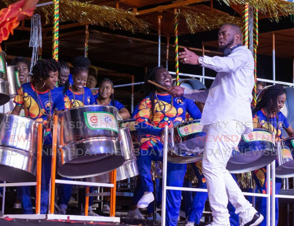 Arranger Stefon West conducts NGC Couva Joylanders to their first National Panorama title in the finals of the medium conventional bands category on Sunday. PHOTO BY DAVID REID  - DAVID REID