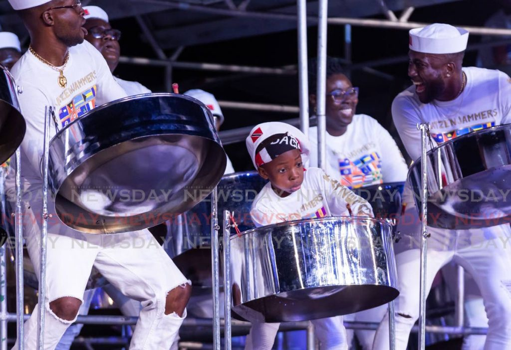 Jadon Phillip, nine, shows off his skills with Katzenjammers during the band's performance in the Panorama medium band final at Dwight Yorke Stadium, Bacelot, Tobago last Sunday. DAVID REID -