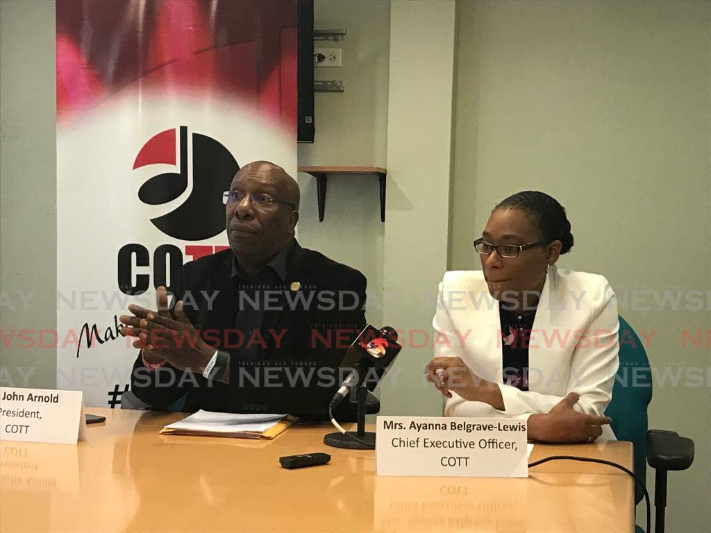 Copyright Organisation of TT (COTT) president John Arnold (left) at a media conference on Tuesday. With him is COTT CEO Ayanna Belgrave-Lewis.   - Julien Neaves