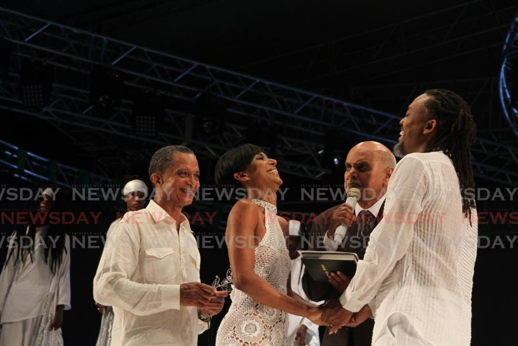 Pastor Clive Dottin officiates The Wedding at Machel Monday, Hasely Crawford Stadium. Photo- - Ayanna