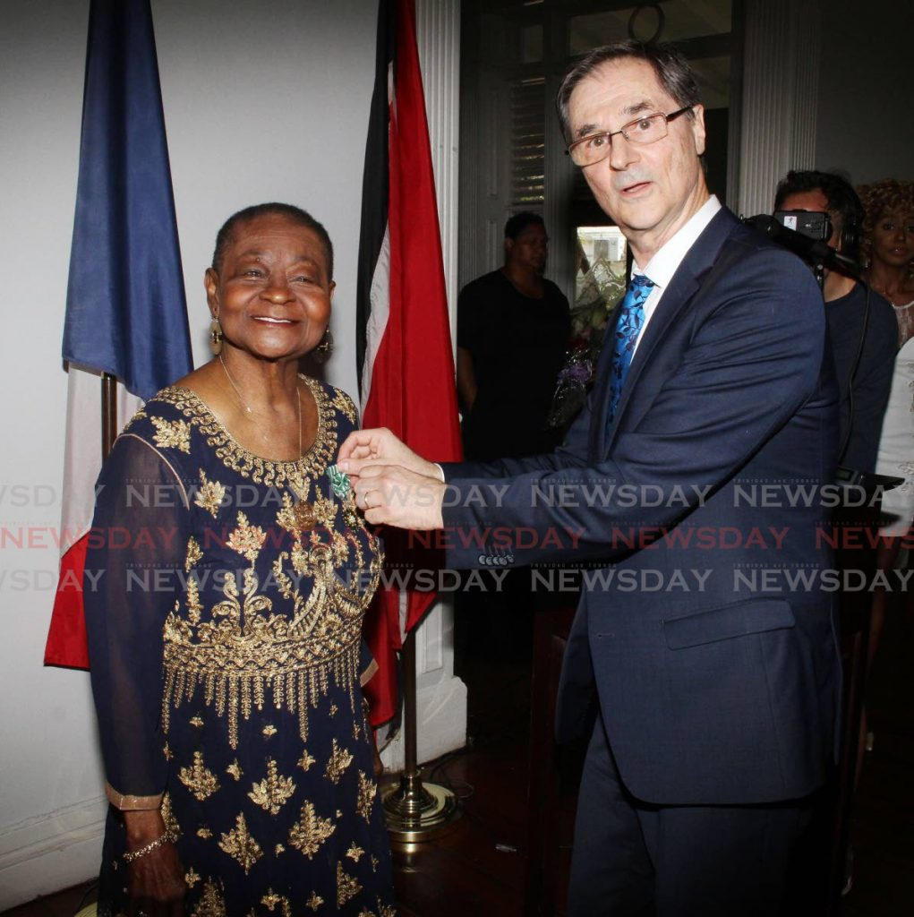 Linda McCartha Monica Sandy-Lewis aka Calypso Rose, is presented with the Officer of the Order of Arts and Letters, the highest French award for Arts and Culture, from French Ambassador Serge Lavroff, at the French Embassy, Mary Street, St, Clair on Thursday. - ANGELO MARCELLE