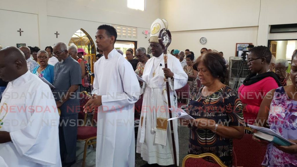 Reverend Bishop Claude Berkley enters the Church of the Transfiguration.  - Roger Jacob