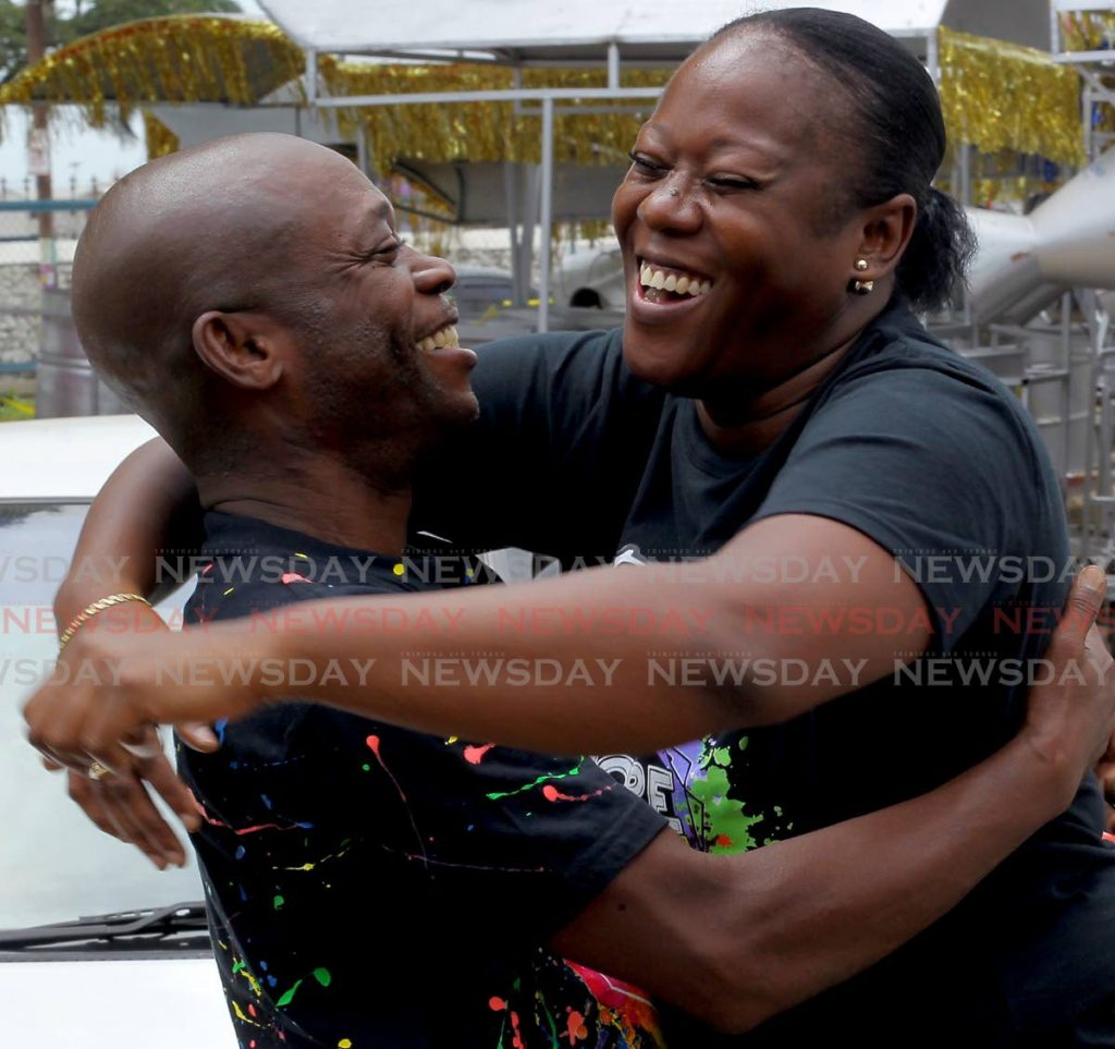 Drill master Curtis Edwards is hugged by Anna-Lisa