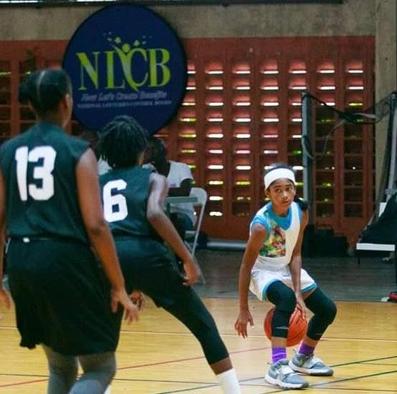 Amira Comissiong (Club Spartans TT) dribbles in front two Maloney Pacers defenders at a recent FemBA tournament. PHOTO COURTESY CARIBBEAN WOMEN SPORTS -