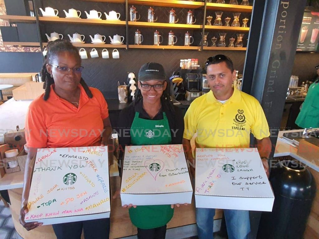 Police officers collect their pastries and coffee from a Starbucks location as part of an initiative the local franchise, under the Prestige Holdings Group, has engaged in with the police service's I Support Our Service initiative.  -