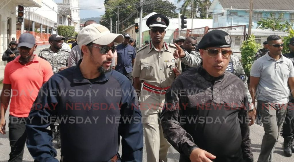 Minister of National Security Stuart Young walks in POS with Commissioner of Police Gary Griffith while discussing security measures for the Carnival on Tuesday morning.  - Ryan Hamilton-Davis