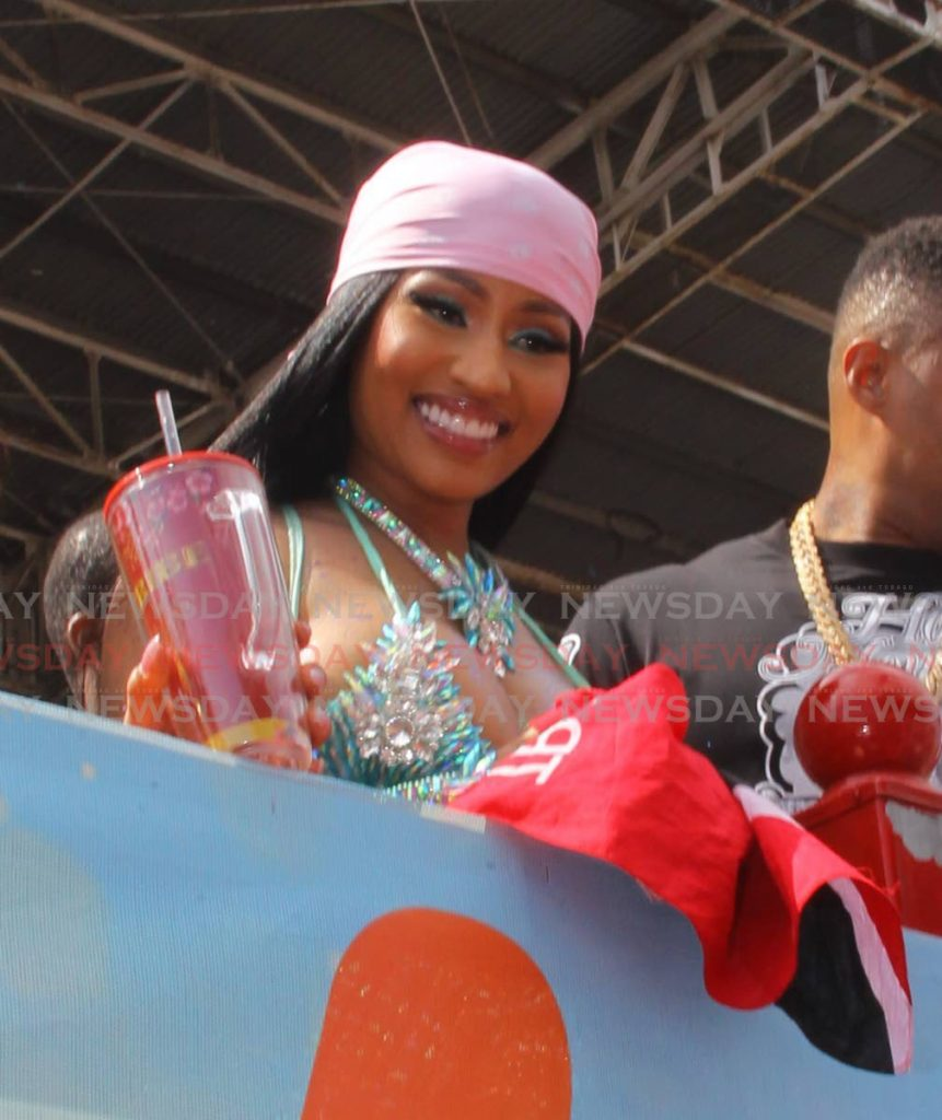 Trini-born US rapper Nicki Minaj looks on in awe as she experiences her first Trinidad Carnival at the Socadrome. - ROGER JACOB
