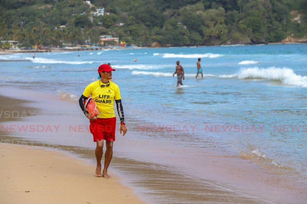 File photo: A lifeguard walks along Maracas Bay.  - JEFF K MAYERS