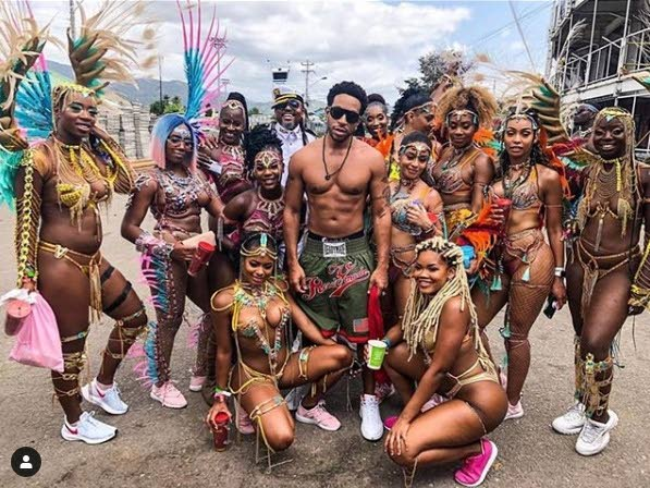 LUDA AND THE LADIES: US rapper/actor Ludacris (Christopher Bridges) is surrounded by female masqueraders. Standing behind him is soca star Machel Montano. - Courtesy Ludacris Instagram