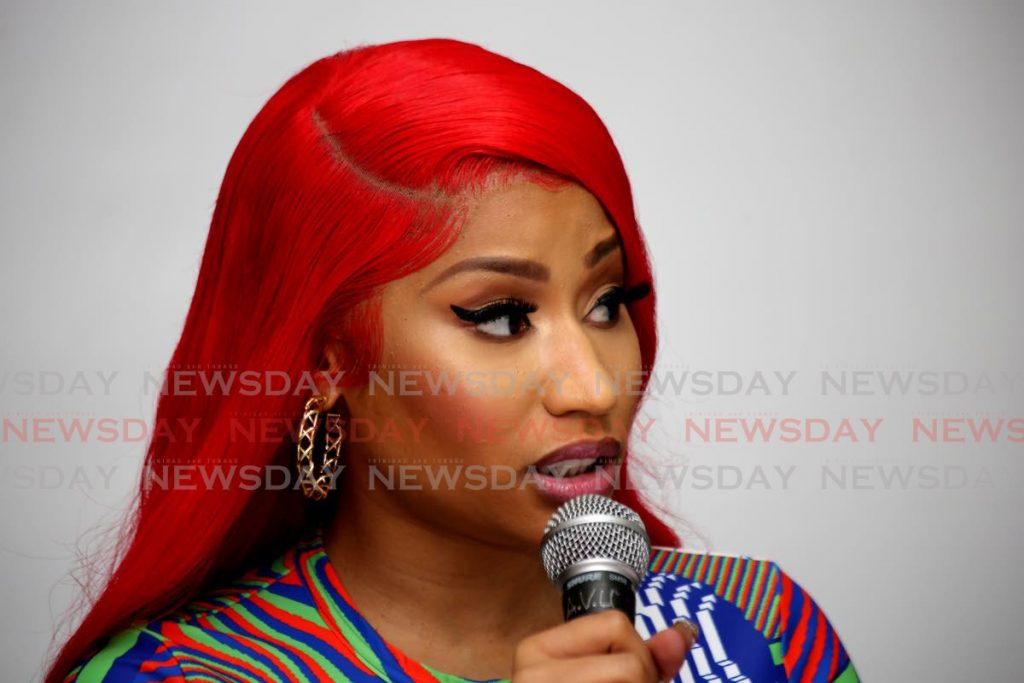 Nicki Minaj speaks to media and young girls at the St Jude's Home for Girls in Belmont, Port of Spain, on Thursday. - Sureash Cholai