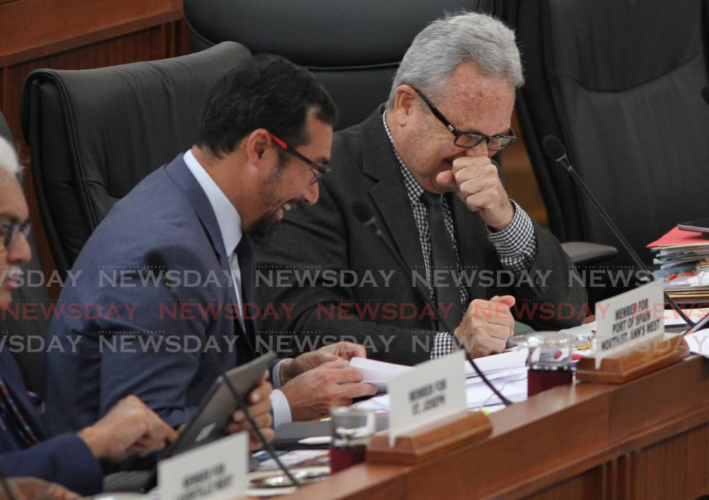GREAT JOKE: National Security Minister Stuart Young shares a great laugh with Finance Minister Colm Imbert during sitting of the House of Representatives.  - Ayanna Kinsale