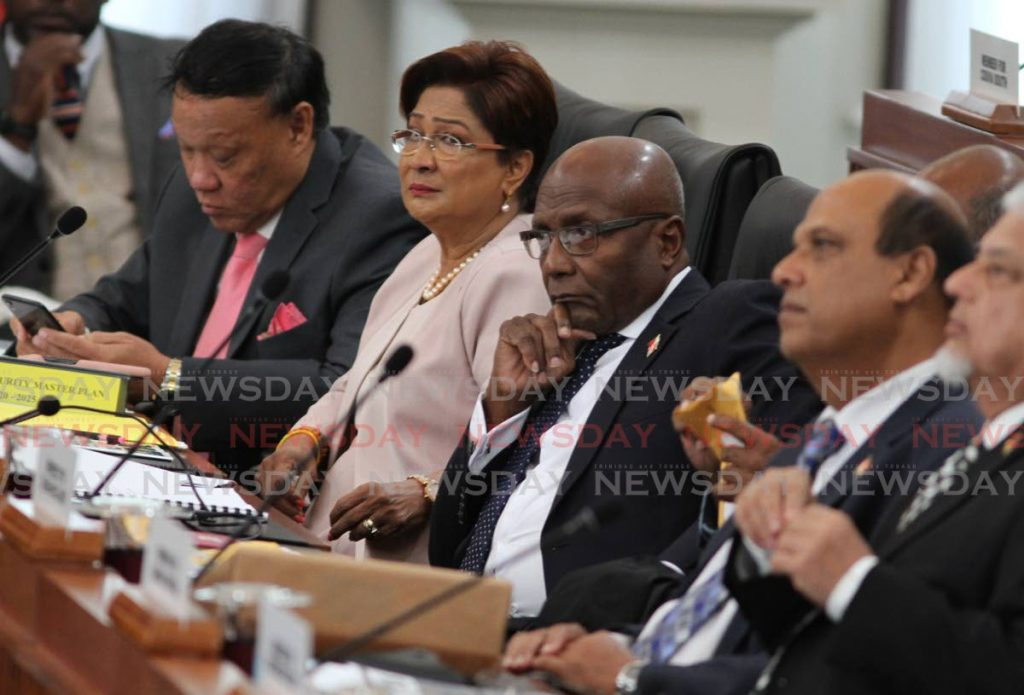 Opposition Leader Kamla Persad-Bissessar, second from left, along with, from left, MPs David Lee, Rodney Charles, Fazal Karim and Bhoendradatt Tewarie in Parliament on Friday. - Ayanna Kinsale