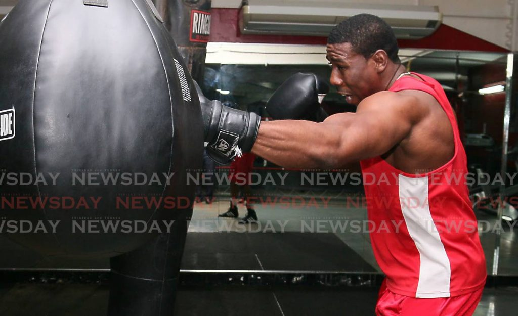 In this file photo, TT boxer and 2016 Olympian Nigel Paul punches  the bag during a training session.  - Angelo Marcelle