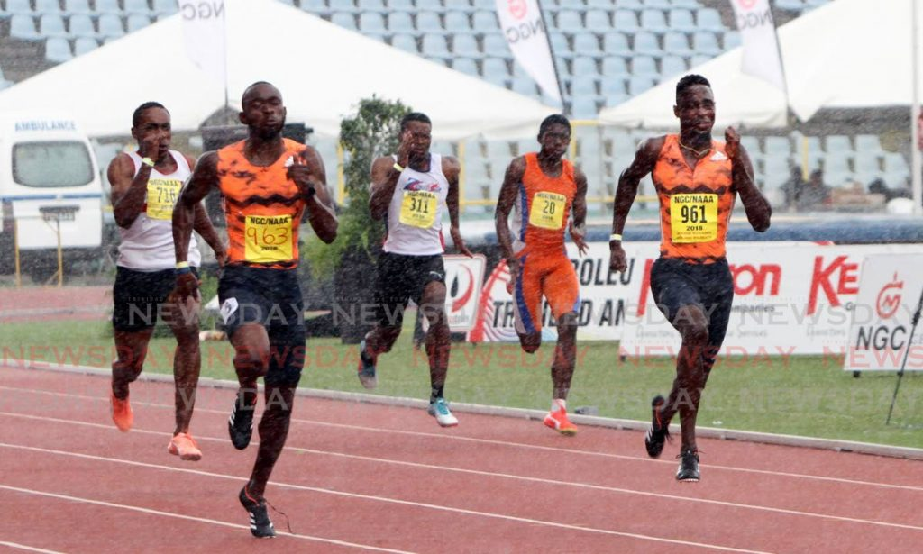 In this June 24, 2018 file photo, Kyle Greaux (second left), outpaces clubmate Jereem Richards (right), to win the Men's 200-metre final, at the NGC/Sagicor/NAAA National Open Championships, held at the Hasely Crawford Stadium, Mucurapo. Photo by Sureash Cholai. - CHOLAI