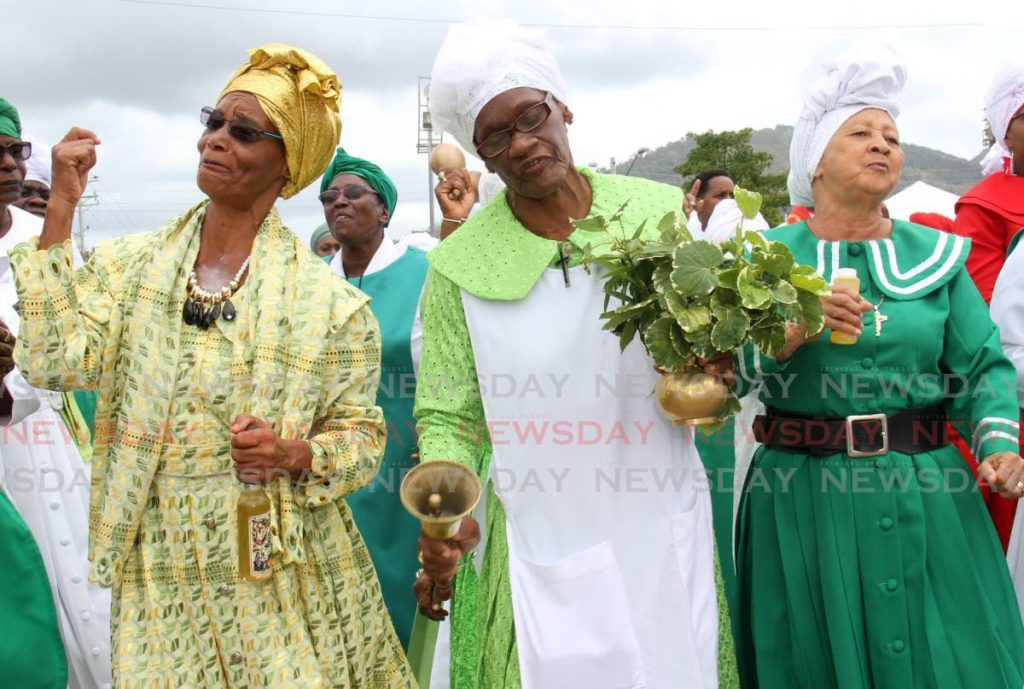 Women sing at the Spiritual Shouter Baptist Liberation Day celebrations at the Eddie Hart Ground in Tacarigua last year. -