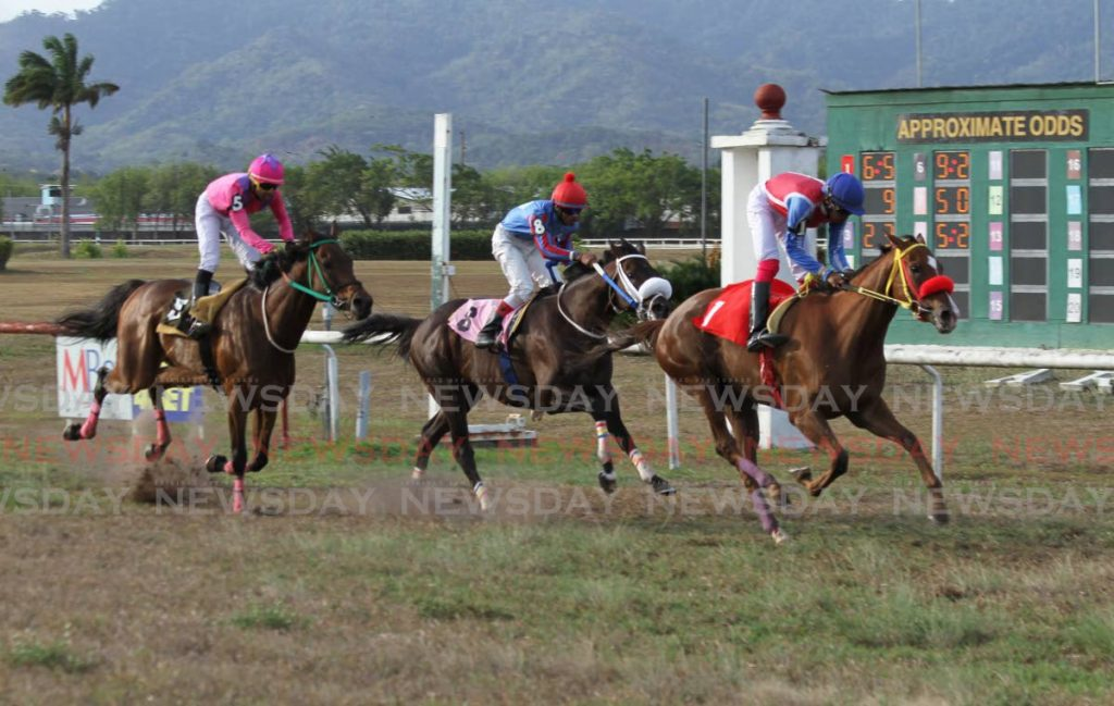In this April 22, 2019 file photo, Awesome April (right), ridden by Rico Hernandez, approaches the finish line to win the Chan Ramlal Limited Champagne Stakes race, at Santa Rosa Park, Arima. Also in photo are runner-up Stockyard (centre) and Root of Jesse, who finished third. - AYANNA KINSALE