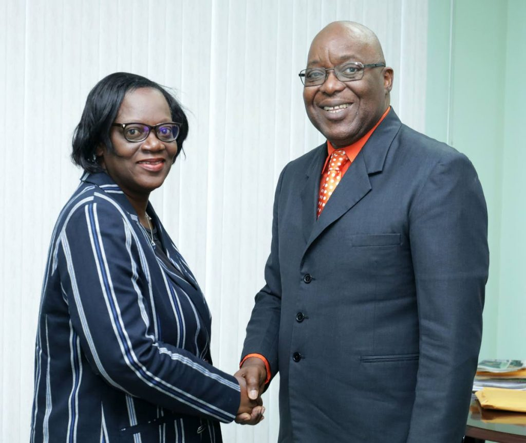 Chief Secretary Kelvin Charles, right, has appointed Chief Administrator Bernadette Solomon-Koroma, left, as a chair of a health task force committee which also comprises ex-TRHA CEO Ashworth Learmont, Dr Anton Cumberbatch, human resource consultant Carol David and Cecile Beckles. PHOTO COURTESY THA  -