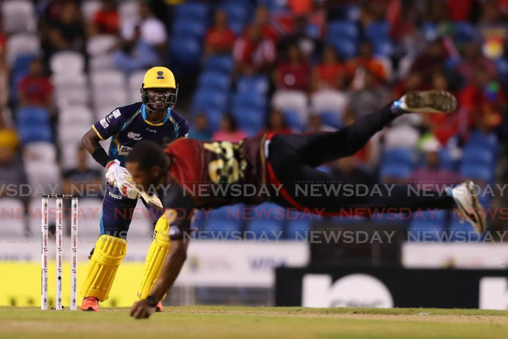 Chris Jordan of Trinbago Knight Riders (front) takes a return catch off Barbados Tridents' Jonathan Carter during A Hero Caribbean Premier League match, on October 10,2019. (Photo courtesy CPL T20) -