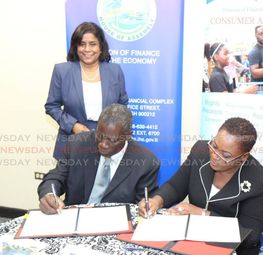 In this November 2019 file photo, Trade and Industry Minister Paula Gopee-Scoon looks on as Ministry of Trade and Industry PS Norris Herbert and THA administrator, finance and economy Denese Toby-Quashie sign an agreement at the Victor E Bruce Financial Complex, Scarborough. Gopee-Scoon on Friday said the pandemic leave policy should be announced this week. -