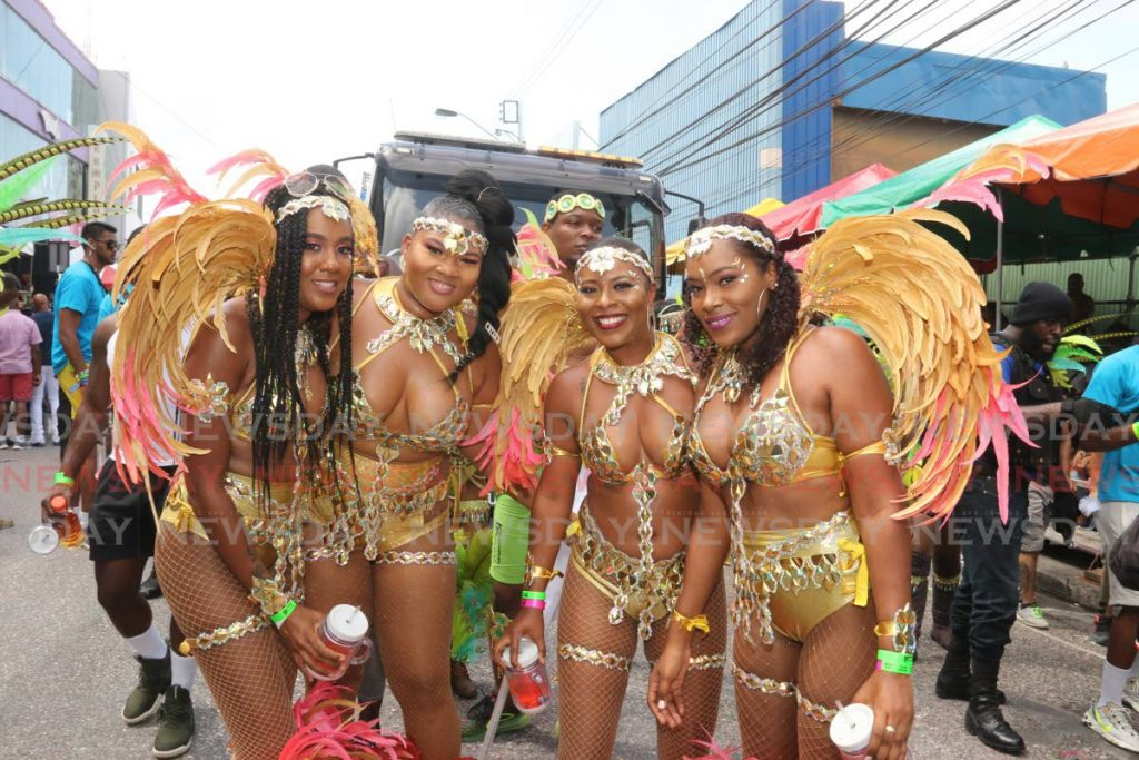 Members of Ivan Kalicharan's Street Jam on High Street, San Fernando on Carnival Tuesday. Street Jam was named San Fernando Carnival Band of the Year. - Marvin Hamilton