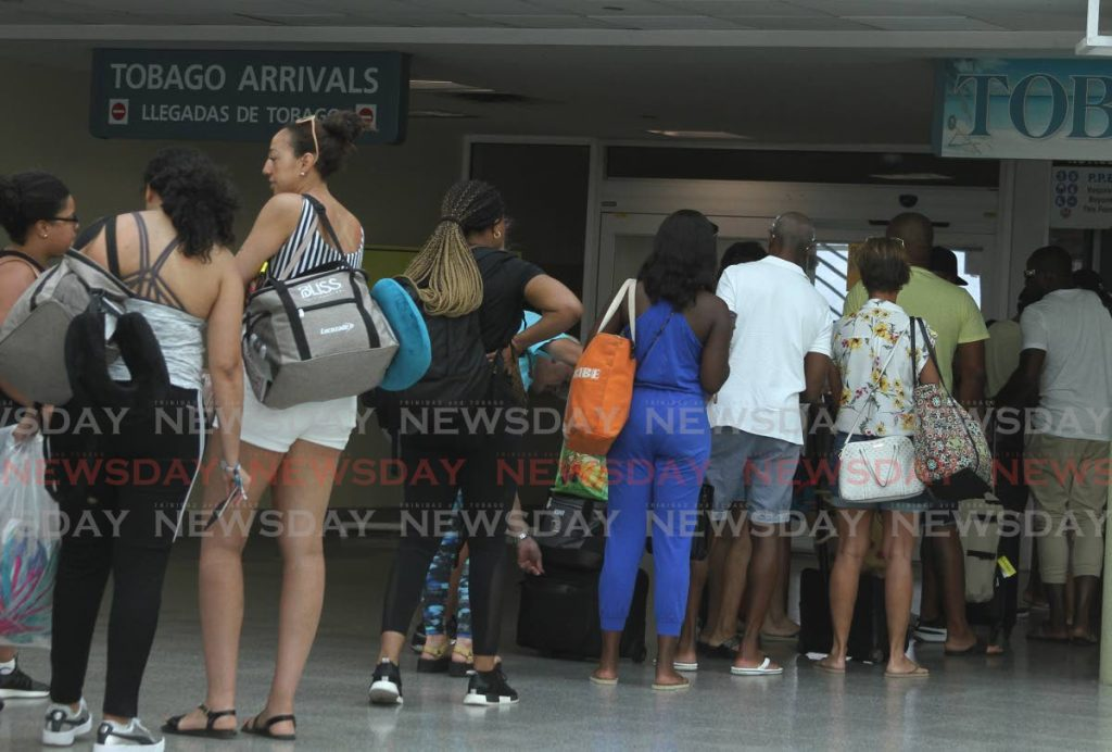 FILE: Passengers at the Piarco International Airport. -