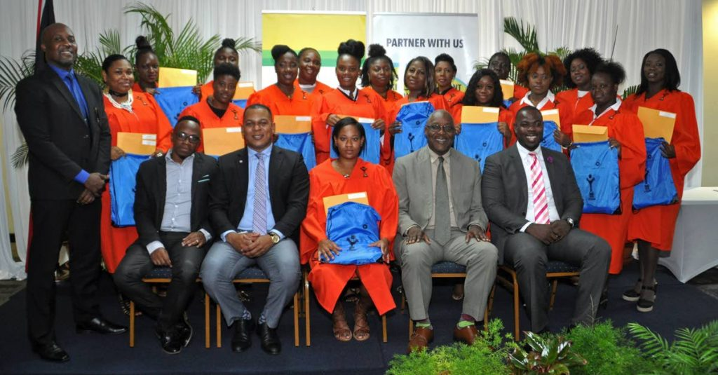 Tobagonian BPTT-YTEPP cosmetology graduates share the spotlight Nigel Parris, standing, left, CEO, YTEPP; Joel Primus sitting, second from left, CSSR advisor, BPTT; and Kelvin Charles, sitting, second from right, Chief Secretary, THA. -