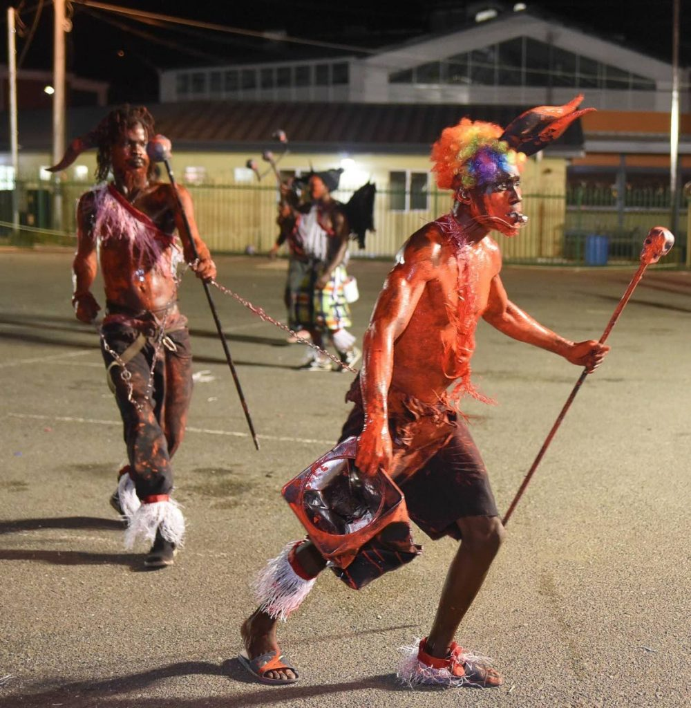Jab molassie roaming the streets of Scarborough during Carnival Monday night mas celebrations last week. PHOTOS COURTESY DIVISION OF TOURISM & CULTURE - DIVISION OF TOURISM & CULTURE