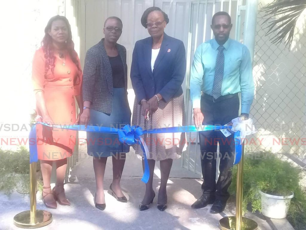 REHAB CENTRE REOPENED: (from left) Eslyn Kent-Baird, manager, Tobago Rehabilitation and Empowerment Centre; Diane Baker-Henry, administrator, Division of Health, Wellness and Family ; Dr Agatha Carrington, Secretary, Division of Health, Wellness and Family Development; and Rev Nigel Daniel, Spring Garden Moravian Church prepare to cut the ribbon to reopen the rehab facility on Friday. PHOTO BY COREY CONNELLY  -