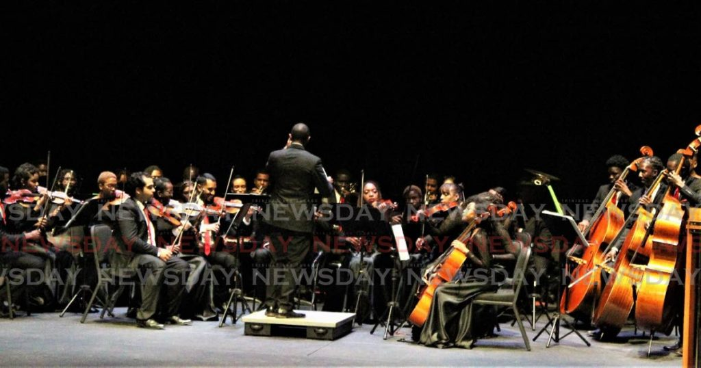 The National Philharmonic Orchestra led by musical director Roger Henry. - GARY CARDINEZ