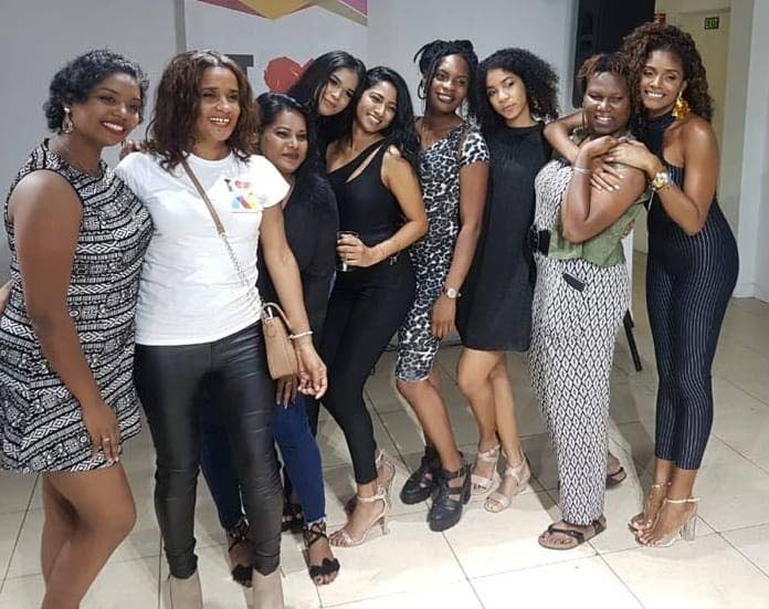 SISTERHOOD: Some of the ladies of Animae Caribe pose for a photo.  -