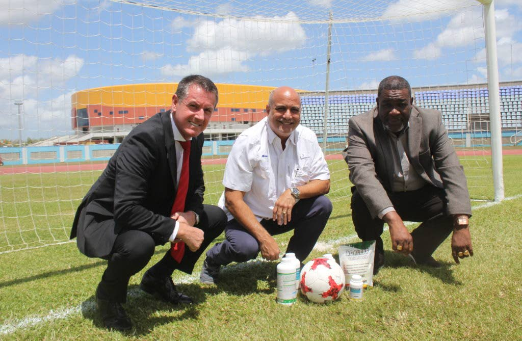 TTFA President William Wallace at right with Caribbean Chemicals chairman Joe Pires and Men?s Senior Team head coach Terry Fenwick on the pitch at the Ato Boldon Stadium.  - TTFA