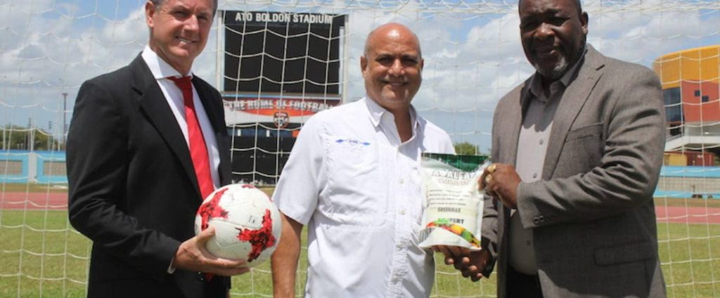 In this file photo, former TT Football Association president William Wallace (R) stands alongside Caribbean Chemicals cairman Joe Pires and senior men's head coach Terry Fenwick on the pitch at the Ato Boldon Stadium.  - TTFA Media
