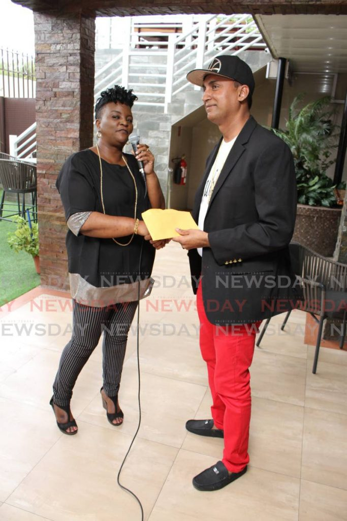 Winner of the Champions of the East Soca Monarch competition Ravi Ratiram sings his soca song Coming Home, at the La Horquetta Carnival Committee prize-giving event at Runway Hotel and Restaurant, Piarco last Tuesday. - Angelo Marcelle