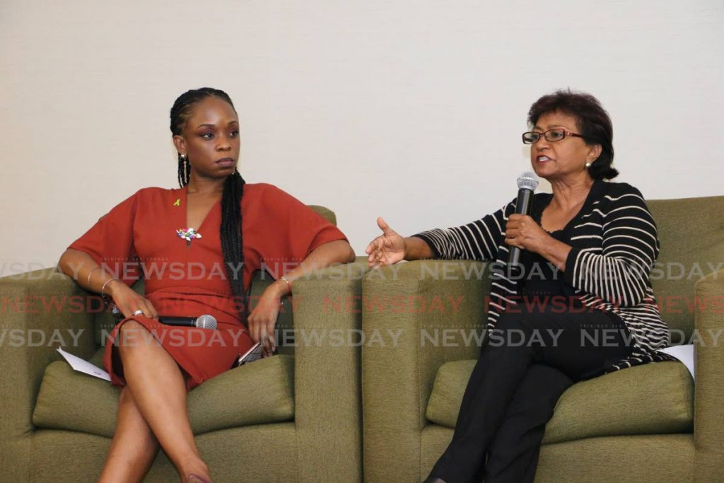 Hulsie Bhaggan, right, and  Kelly Mc Farlane discuss addiction and mental health in women in the country at the Central Finance Facility's breakfast meeting at the Hyatt Regency in Port of Spain on Monday. - Rhianna Mc Kenzie
