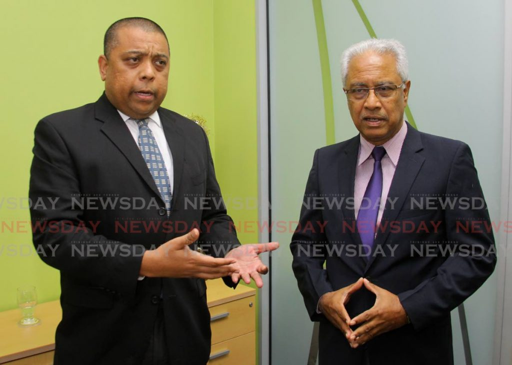 TT Fair Trade Commission chairman Ronald Ramkissoon and esecutive director Bevan Narinesingh speak with Business Day at the organisation's Level 12 Nicholas Tower, Port of Spain office. - ROGER JACOB