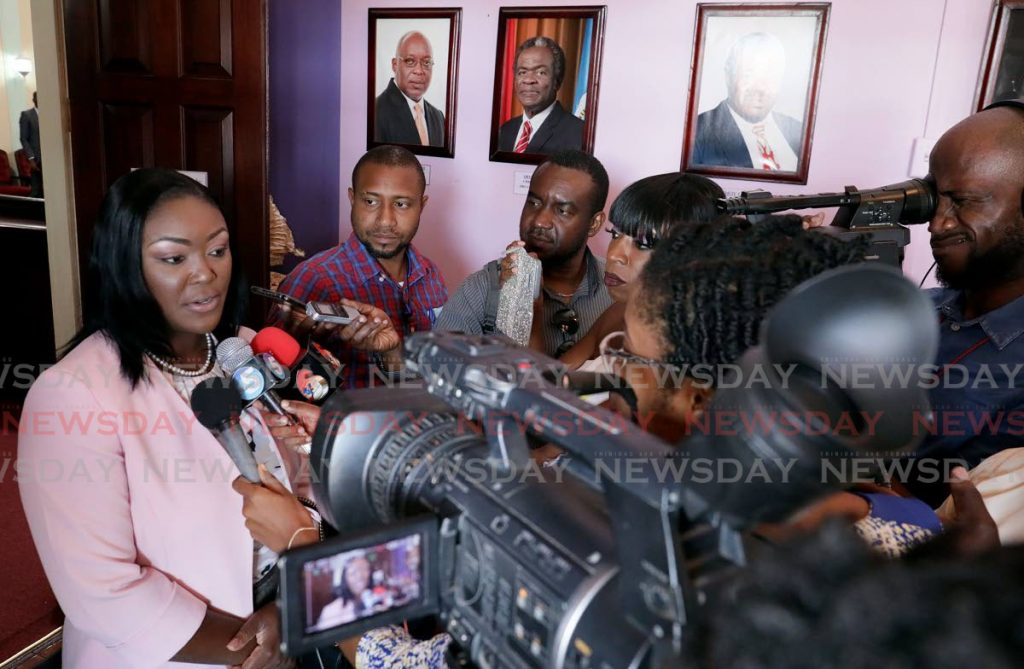 New health secretary Tracy Davidson-Celestine, left, talks to the media about her immediate plans after being installed as a Councillor on Wednesday at the Assembly Legislature, Scarborough. PHOTO COURTESY THA  -
