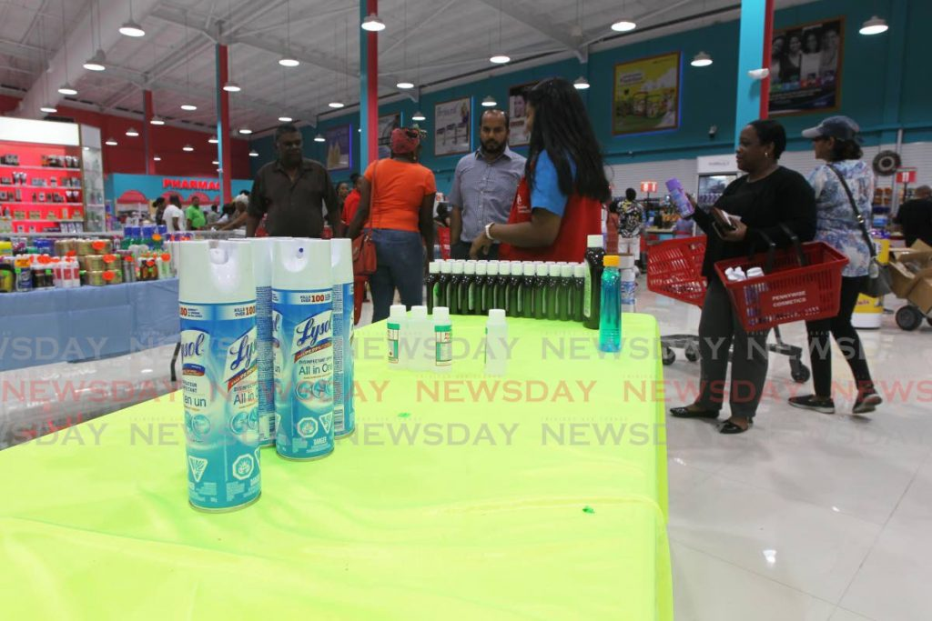 A table is almost empty after being full of cleaning products just a few moments before as customers stock up on items at Pennywise Plaza Chaguanas, as TT's first case of covid19 was confirmed by Government on Thursday. - Lincoln Holder