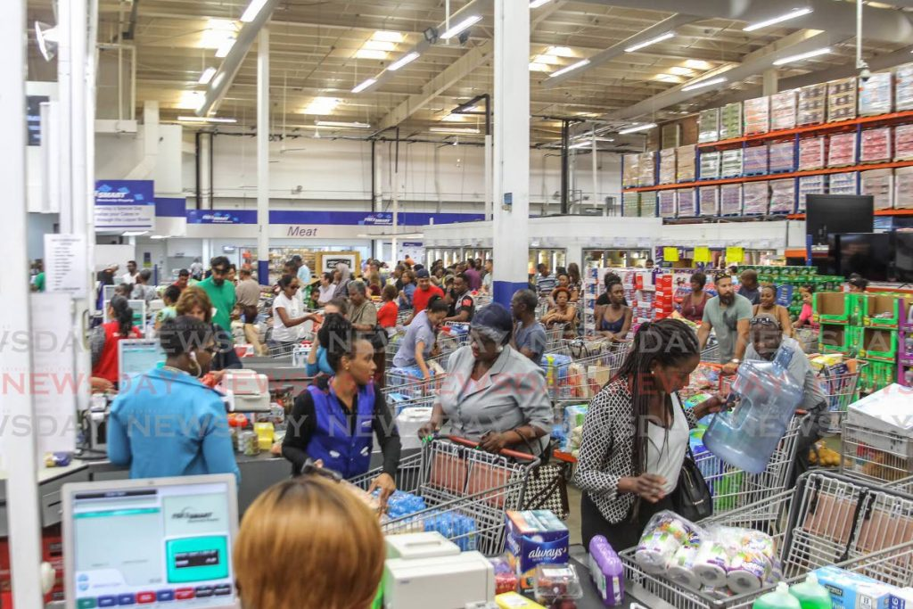 FLASHBACK: Pricesmart Members flood stores nationwide, as households attempt to acquire cleaning and sanitory products from the shelves, Pricesmart Movietowne, Invaders Bay, Port of Spain, March 12. - ROGER JACOB