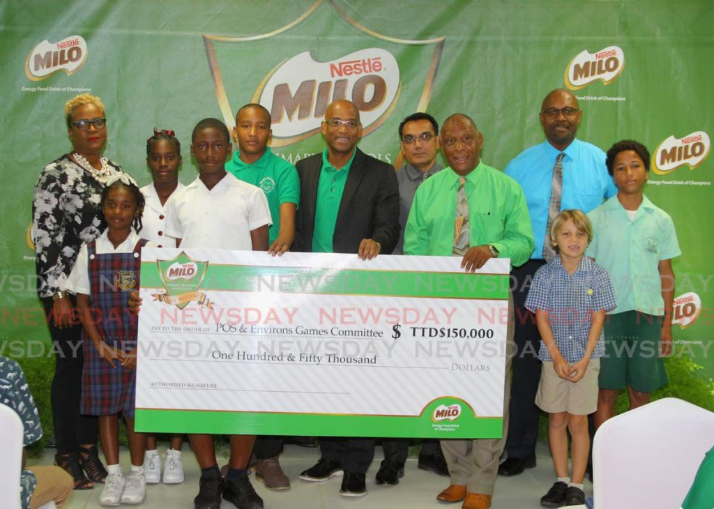 Nestle's business executive officer Raymond Wallace, centre, stands alongside chairman of the organising committee of the 33rd Milo Primary Schools Games Kelvin Nancoo, fourth from right, during the launch, on Thursday, of the games,at Nestle TT's head office, Valsayn. - ROGER JACOB