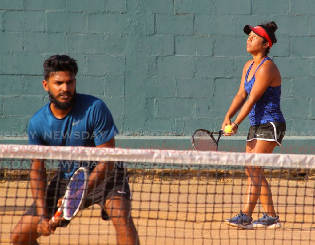 Carlista Mohammed (R) and Nabeel Mohammed take part in the mixed doubles semi- finals of the Shell Tranquillity tennis tournament,at the Tranquillity Courts, Victoria Avenue, Port of Spain, on Thursday. - ROGER JACOB