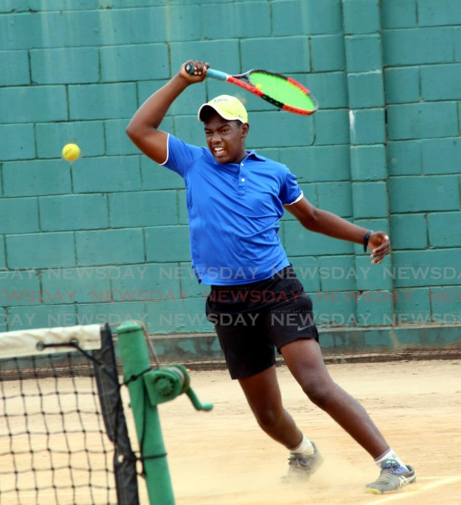 Saqiv Williams competes in the Shell Tranquillity Open Tennis Tournament 2020, at Tranquillity Tennis Court, Victoria Avenue, Port of Spain, on Saturday. Williams advanced to round three of the men's singles. PHOTO BY SUREASH CHOLAI -