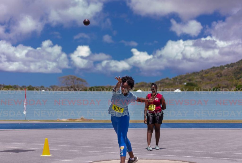 Kadyann Pierre competes in the girls under-17 shot put in the National Secondary Schools Track and Field Championships,  at the Dwight Yorke Stadium.  - DAVID REID
